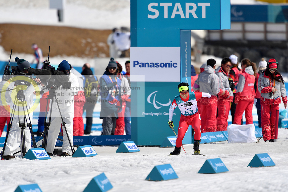 HOSHIZAWA Masaru JPN LW8 competing in the ParaBiathlon, Para Biathlon at  the PyeongChang2018 Winter Paralympic Games, South Korea.