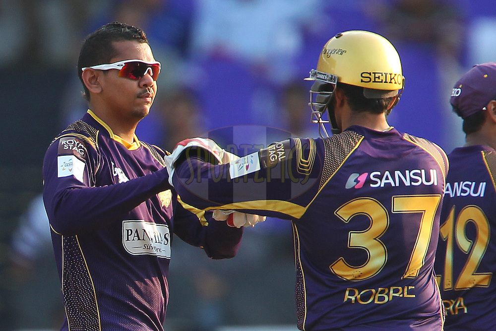 Sunil NARINE of the Kolkata Knight Riders celebrates the wicket of Travis BIRT of the Hobart Hurricanes  during the first semi final match of the Oppo Champions League Twenty20 between the Kolkata Knight Riders and the Hobart Hurricanes held at the Rajiv Gandhi Cricket Stadium, Hyderabad, India on the 2nd October 2014<br /> <br /> Photo by:  Ron Gaunt / Sportzpics/ CLT20<br /> <br /> <br /> Image use is subject to the terms and conditions as laid out by the BCCI/ CLT20.  The terms and conditions can be downloaded here:<br /> <br /> http://sportzpics.photoshelter.com/gallery/CLT20-Image-Terms-and-Conditions-2014/G0000IfNJn535VPU/C0000QhhKadWcjYs