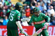 50 - Shakib Al Hasan (vc) of Bangladesh celebrates scoring a half century with Mushfiqur Rahim (wk) of Bangladesh during the ICC Cricket World Cup 2019 match between England and Bangladesh the Cardiff Wales Stadium at Sophia Gardens, Cardiff, Wales on 8 June 2019.