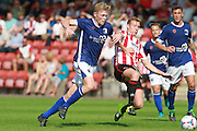 Sam Cosgrove and Kyle Storer during the Vanarama National League match between Cheltenham Town and Barrow at Whaddon Road, Cheltenham, England on 22 August 2015. Photo by Antony Thompson.