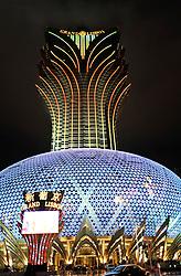 Illuminated new Grand Lisboa casino and hotel at night in Macau China 2008