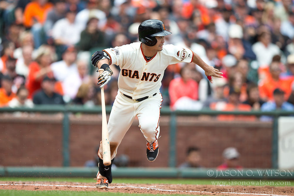 SAN FRANCISCO, CA - MAY 21:  Nori Aoki #23 of the San Francisco Giants runs to first base after hitting an infield single against the Los Angeles Dodgers during the third inning at AT&T Park on May 21, 2015 in San Francisco, California.  The San Francisco Giants defeated the Los Angeles Dodgers 4-0. (Photo by Jason O. Watson/Getty Images) *** Local Caption *** Nori Aoki