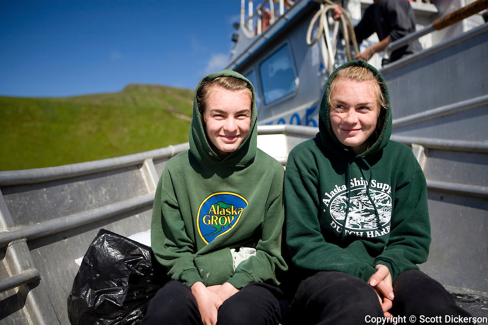Commercial fishing deckhands and sisters, Claire and Emma Teal Laukitis, Eastern Aleutian Islands, Alaska.