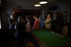 "© London News Pictures. ""Looking for Nigel"". A body of work by photographer Mary Turner, studying UKIP leader Nigel Farage and his followers throughout the 2015 election campaign. PICTURE SHOWS - Local UKIP supporters in The Kings Head pub in Grimsby, Lincolnshire, await the arrival of Nigel Farage, to pull a pint of a local ale that has been named 'Farageale' in his honour, on April 8th 2015. However, the UKIP leader failed to arrive due to security concerns and instead went to a cafe around the corner for fish and chips with Joey Essex. . Photo credit: Mary Turner/LNP **PLEASE CALL TO ARRANGE FEE** **More images available on request**"