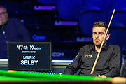 Mark Selby sits and looks on as Ronnie O'Sullivan stays at the table for the 2nd frame between Ronnie O'Sullivan vs Mark Selby during the 19.com Home Nations Scottish Open at the Emirates Arena, Glasgow, Scotland on 13 December 2019.
