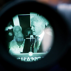 KYLE GREEN | The Roanoke Times<br /> October 12, 2008 - (as seen through the viewfinder of a television camera) Former President Bill Clinton addresses a large crowd in downtown Roanoke during an appearance  campaigning for Democratic presidential candidate Barack Obama.