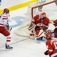 11 April 2009:   Boston University forward Zach Cohen (11) scores a goal with less than a minute remaining in the 3rd period against Miami University goalie Cody Reichard (30) at the Verizon Center in Washington, DC in the Division I Mens Ice Hockey Championship.  The Boston University Terriers defeated the Miami University (Ohio) Redhawks 4-3 in overtime to win the NCAA Mens Ice Hockey Championship.