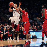 Josh Fortune, Providence, drives to the basket during the Providence Vs St. John's Red Storm basketball game during the Big East Conference Tournament at Madison Square Garden, New York, USA. 12th March 2014. Photo Tim Clayton
