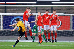 MERTHYR TYDFIL, WALES - Thursday, November 2, 2017: Wales' Toby Vickery, Connor Randall, Charlie Hughes and Chris Craven defend a free-kick from Newport County's Elis Watts during an Under-18 Academy Representative Friendly match between Wales and Newport County at Penydarren Park. (Pic by David Rawcliffe/Propaganda)