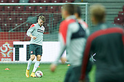 Poland's Lukasz Piszczek kicks the ball while warm up during official training one day before the EURO 2016 qualifying match between Poland and Germany on October 10, 2014 at the National stadium in Warsaw, Poland<br /> <br /> Picture also available in RAW (NEF) or TIFF format on special request.<br /> <br /> For editorial use only. Any commercial or promotional use requires permission.<br /> <br /> Mandatory credit:<br /> Photo by &copy; Adam Nurkiewicz / Mediasport