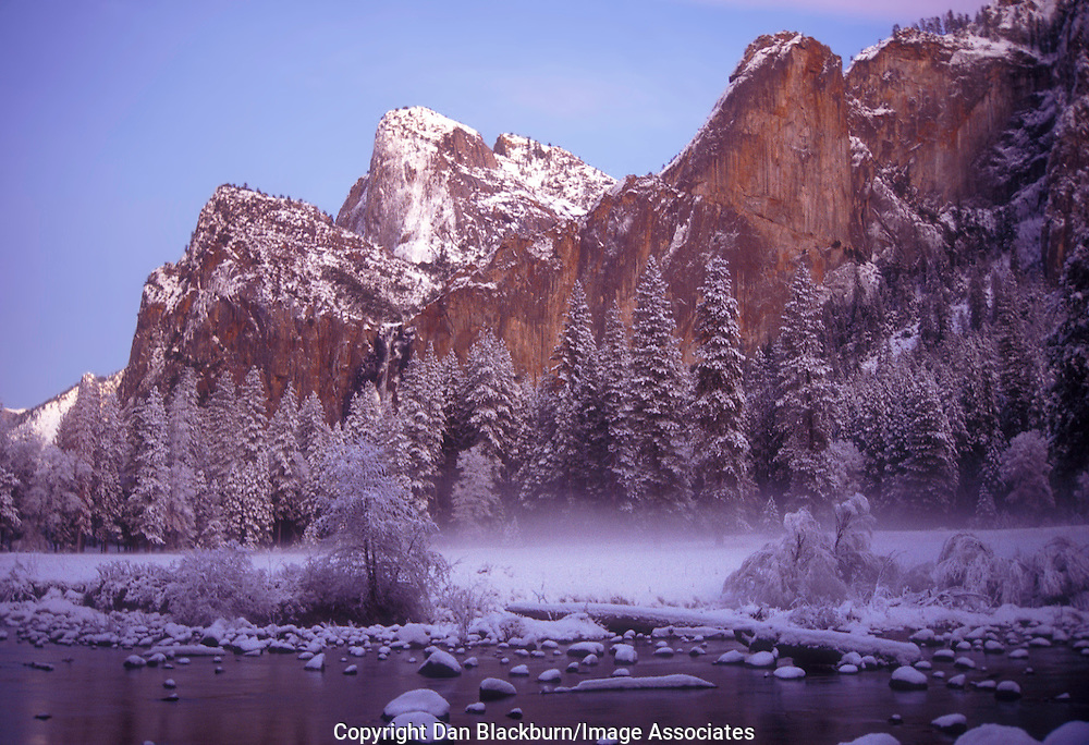 The Setting Sun Illuminates Cathedral Rocks and the Merced River in Winter in Yosemite National Park California