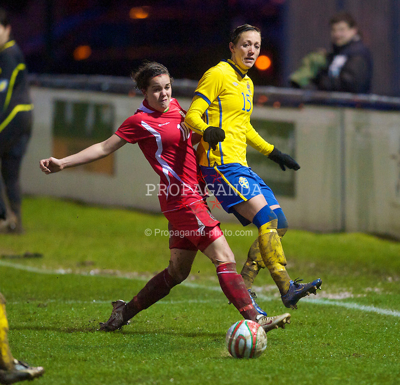 BROUGHTON, ENGLAND - Wednesday, March 31, 2010: Wales' Gwennan Harries and Sweden's Therese Sjogran during the FIFA Women's World Cup 2011 Qualifying Group 8 match at the Airfeld. (Pic by David Rawcliffe/Propaganda)