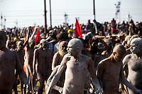Thousands of Naga Sadhu make their way through the crowds of the Kumbh Mela.