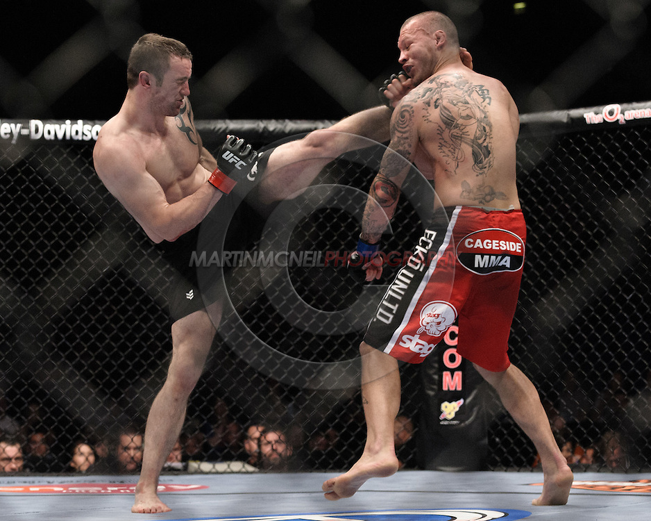 """LONDON, ENGLAND, JUNE 7, 2008: Paul Talyor (left) lands a kick to the head of Jess Liaudin during """"UFC 85: Bedlam"""" inside the O2 Arena in Greenwich, London on June 7, 2008."""