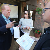 Chauncey Godwin, Reagan Pepper, with The Tupelo Downtown Main Street Association, and Neal McCoy, with Tupelo CVB, discuss the locations of the Tupelo Bicentennial Photo Project as they look over a maps passed out by Pepper during the unveilings Thursday morning at Reed's in downtown Tupelo.