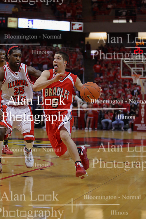 """31 January 2009: Sam Maniscalco heads for the lane defended by Champ Oguchi. The Illinois State University Redbirds join the Bradley Braves in a tie for 2nd place in """"The Valley"""" with a 69-65 win on Doug Collins Court inside Redbird Arena on the campus of Illinois State University in Normal Illinois"""