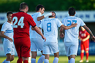 Picture by Ian Wadkins/Focus Images Ltd +44 7877 568959<br /> 25/07/2013<br /> Goran Mujanović of FC Rijeka congratulated by teammates after scoring 3rd goal during the second leg of the UEFA Europa League round two qualifying match at Belle Vue Stadium, Rhyl.