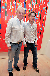 Left to right, SIR FRANK LOWE and his son SEBASTIAN LOWE  at an exhibition of photographic portraits by Bryan Adams entitled 'Hear The World' at The Saatchi Gallery, King's Road, London on 21st July 2009.