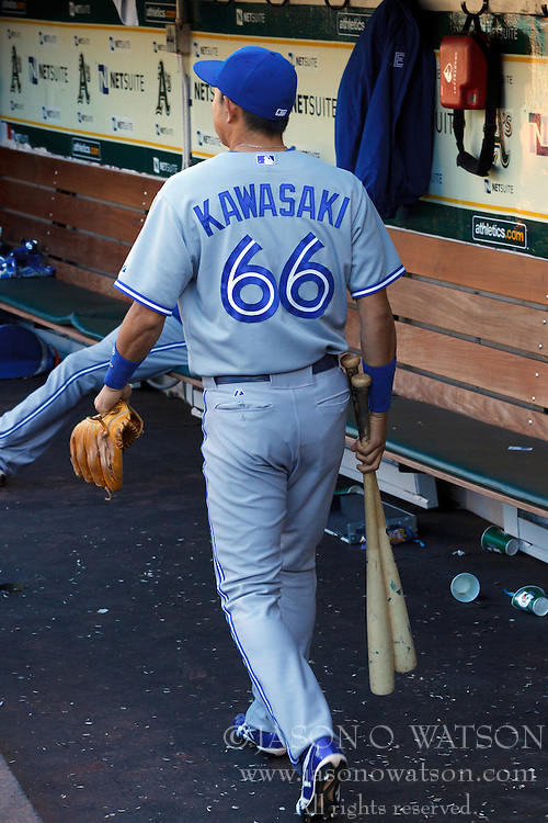 OAKLAND, CA - JULY 05:  Munenori Kawasaki #66 of the Toronto Blue Jays enters the dugout before the game against the Oakland Athletics at O.co Coliseum on July 5, 2014 in Oakland, California. The Oakland Athletics defeated the Toronto Blue Jays 5-1.  (Photo by Jason O. Watson/Getty Images) *** Local Caption *** Munenori Kawasaki
