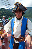 Pirate on board the Pirate Ship on Lake Ashi, a scenic lake in Hakone. The lake is known for its views of Mt. Fuji.  Several ferries cruise the lake, providing scenic views for passengers. One of the boats is a full-scale replica of a man-of-war pirate ship.