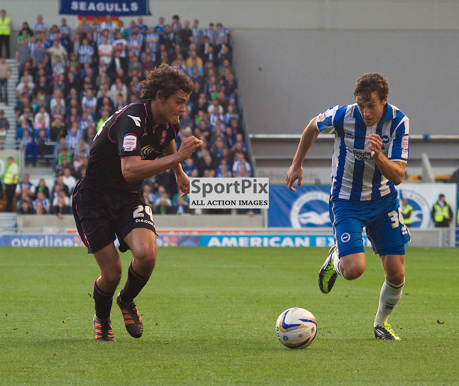 BRIGHTON. UK. 29/09/2012. Birmingham City's Will Packwood and Brighton and Hove Albion's Will Buckley at the match between Brighton and  Hove Albion FC and Birmingham City FC held at the American Express Community Stadium Falmer. © Peter Webb | STOCKPIX.EU. Photo credit: Peter Webb | STOCKPIX.EU