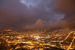 South America, Ecuador, Pichincha province, Quito. City at night, with floodlit cathedrals.