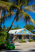 Souvenir and watersports equipment shop Yolo and palm trees in downtown Captiva Island in Florida, USA