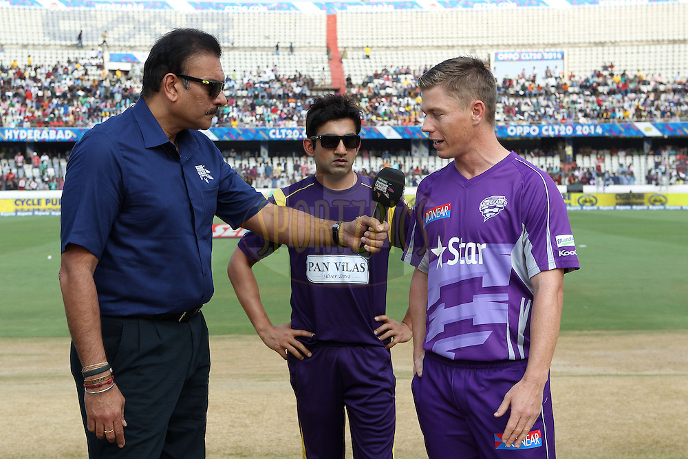 Xavier Docherty(Captain) of the Hobart Hurricanes and Gautam GAMBHIR (Captain) of the Kolkata Knight Riders  after the toss during the first semi final match of the Oppo Champions League Twenty20 between the Kolkata Knight Riders and the Hobart Hurricanes held at the Rajiv Gandhi Cricket Stadium, Hyderabad, India on the 2nd October 2014<br /> <br /> Photo by:  Ron Gaunt / Sportzpics/ CLT20<br /> <br /> <br /> Image use is subject to the terms and conditions as laid out by the BCCI/ CLT20.  The terms and conditions can be downloaded here:<br /> <br /> http://sportzpics.photoshelter.com/gallery/CLT20-Image-Terms-and-Conditions-2014/G0000IfNJn535VPU/C0000QhhKadWcjYs