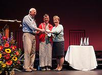 Bill and Lynne Burns receive the 2014 Hurst Award from Ellen Hurst at the Winnipesaukee Playhouse Wednesday evening.  (Karen Bobotas/for the Laconia Daily Sun)