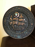 17 in diameter metal plate with ship on it and decoration<br />