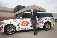 Bob Simpson, President and COO of Jelly Belly with a Jelly Belly wrapped vehicle outside their Fairfield, Calif. factory