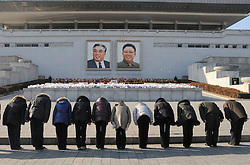 Moment of silence during the inaugural ceremony for the renovated Kumsusan Palace of the Sun, where the embalmed bodies of Kim Il Sung and Kim Jong Il are laid in Pyongyang, capital of the Democratic People s Republic of Korea (DPRK), on Dec. 17, 2012.), December 17, 2012, Photo by Imago / i-Images...UK ONLY
