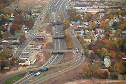 I-95 in New Haven Connecticut with the old Woodward Avenue School being razed. Aerial Photograph taken November 8, 2005 at peak autumn foliage. Construction progress image capture. Showing interchanges, overpasses and Amtrak rail right of way where applicable.