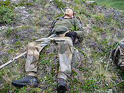 Exhausted hunter during a successful Dall Sheep in the Chugach Mountains of Alaska