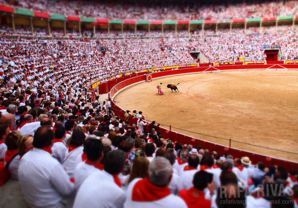 French matador Sebastian Castella performs a pass with capote to a Victoriano del Rio Cortes' bull, during the sixth corrida of the San Fermin festival, at the the Northern Spanish city of Pamplona's bullring, on July 12, 2012. PHOTO / Rafa Rivas
