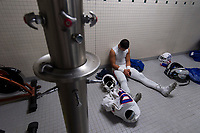 Folsom Bulldogs Cruz Lara (30), gets ready inside the locker room before the game as the Granite Bay Grizzly's varsity football team host the Folsom Bulldog's at Granite Bay High School, Friday Sep 29, 2017.<br /> photo by Brian Baer