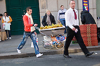 Woman selling banannas from a pram on Capel Street in Dublin Ireland