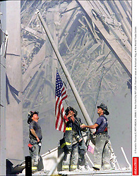 © Franklin Thomas E./KRT/ABACA. 28646-1. New York City-NY-USA. Firemen raise an American flag at the World Trade Center.  | 28646_01