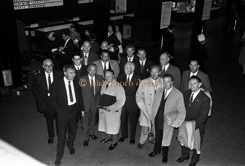 19/09/1963<br /> 09/19/1963<br /> 19 September 1963<br /> Massey Ferguson group departing Dublin for Paris Factory visit. A party of 23 executives of Massey Ferguson (Eire) Ltd. and dealers went on a three day visit to the Massey Ferguson factory at Beauvais, Paris as guests of Massey Ferguson France. Picture shows members of the group at Dublin Airport including Mr. M. Henderson, Director and General Manager, Massey Ferguson (Eire) Ltd.; Mr. J.J. McCormick, Retail Sales Manager and Mr. J. O'Connor, Service Manager.