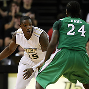 Central Florida forward David Diakite (15) and Marshall guard DeAndre Kane (24) during a Conference USA NCAA basketball game between the Marshall Thundering Herd and the Central Florida Knights at the UCF Arena on January 5, 2011 in Orlando, Florida. Central Florida won the game 65-58 and extended their record to 14-0.  (AP Photo/Alex Menendez)