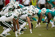 The New York Jets offensive line gets set at the line of scrimmage as it lines up opposite the Miami Dolphins defensive line during the NFL week 9 regular season football game against the Miami Dolphins on Sunday, Nov. 4, 2018 in Miami Gardens, Fla. The Dolphins won the game 13-6. (©Paul Anthony Spinelli)