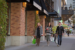 United States, Washington, Bellevue, young women with shopping bags.  MR