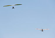 A Dragonfly aero-tug, at right, tows a hang glider into the sky above Randall Airport in Middletown on Friday, Aug. 23, 2013.
