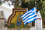 Corfu flag and Greek Orthodox religious iconic painting madonna Mary and Jesus Christ, Paleokastritsa Monastery, Corfu, Greece