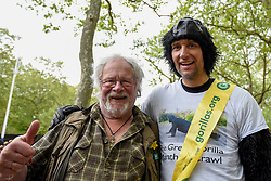 "© Licensed to London News Pictures. 29/04/2017. London, UK. Met Police officer Tom Harrison, 41, known as ""Mr Gorilla"", celebrates with wildlife presenter Bill Oddie, after finally completing the London Marathon after six days of crawling and raising £23,900 for The Gorilla Organisation.   Photo credit : Stephen Chung/LNP"