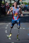London. United Kingdom. 2014 London Marathon. David WHITEHEAD running through  Narrow Street, Limehouse, East London. Athletics 11:03:29  Sunday  13/04/2014  [Mandatory Credit; Peter SPURRIER/ Intersport Images],