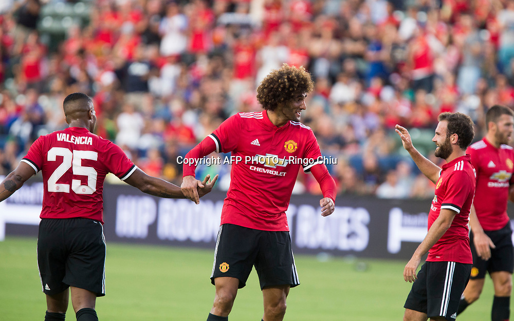 Manchester United Marouane Fellaini, center, celebrates his goal with teammates against Los Angeles Galaxy  during the first half of a national friendly soccer game at StubHub Center on July 15, 2017 in Carson, California.   AFP PHOTO / Ringo Chiu
