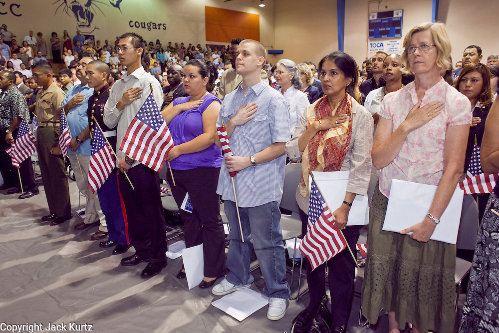"04 JULY 2009 -- PHOENIX, AZ: Candidates for citizenship say the ""Pledge of Allegiance"" before being sworn in as US citizens at a naturalization ceremony in Phoenix, AZ, July 4. U.S. Citizenship and Immigration Services and South Mountain Community College in Phoenix, AZ, hosted the 21st annual ""Fiesta of Independence"" Saturday, July 4. More than 180 people from 58 countries took the US Oath of Citizenship and became naturalized US citizens. The ceremony was one of dozens of similar ceremonies held across the US this week. USCIS said more than 6,000 people were naturalized US citizens during the week.  Photo by Jack Kurtz / ZUMA Press"