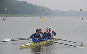 Amsterdam. NETHERLANDS. GBR LM4-. Mark ALDRED, Peter and Richard CHAMBERS, Chris BARTLEY with coach, Rob MORGAN. Tuesday morning training, wet and misty.   2014 FISA  World Rowing. Championships.  De Bosbaan Rowing Course . 09:05:49  Tuesday  26/08/2014  [Mandatory Credit; Peter Spurrier/Intersport-images]