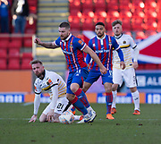 24th March 2018, McDiarmid Park, Perth, Scotland; Scottish Football Challenge Cup Final, Dumbarton versus Inverness Caledonian Thistle; Iain Vigurs of Inverness Caledonian Thistle takes the ball away from Danny Handling of Dumbarton